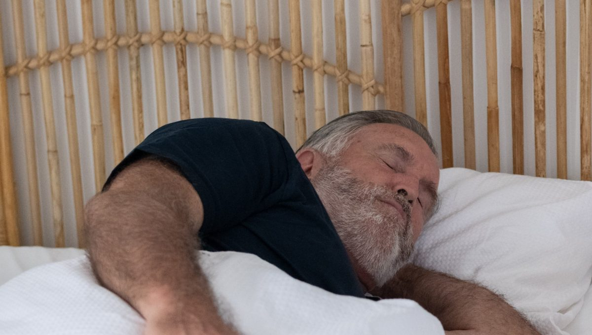 Male Patient Sleeping Soundly With SomnoMed Device